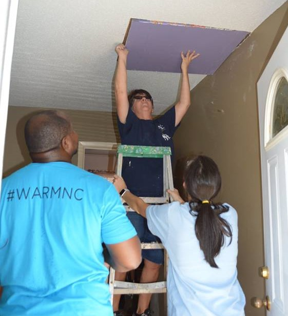 WARM Field Supervisor, Dwayne Goodman, oversees volunteers repairing a home damaged by Hurricane Florence.
