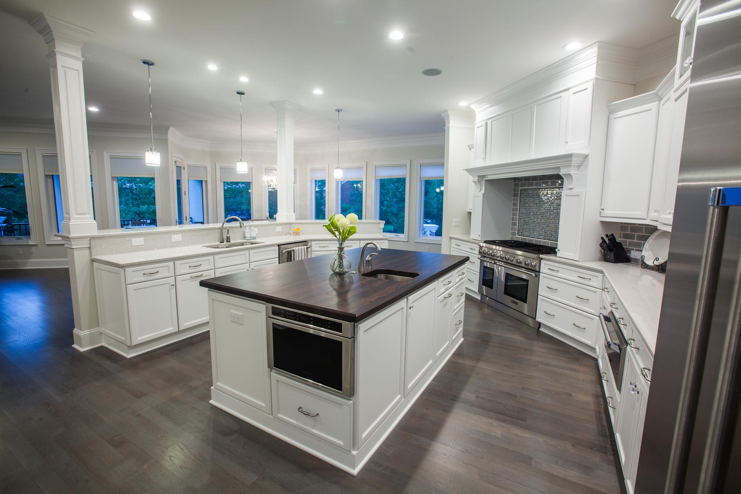 All white custom kitchen features bright modern decor by for Webs custom kitchen